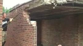 Mr Weir pictured moments before the garage wall collapsed on him