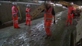 Workmen in tunnel