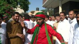 Men dancing in the street in Peshawar