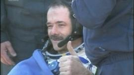 Commander Hadfield giving thumbs-up