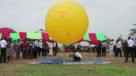 Students in Ghana launch a model satellite attached to a balloon