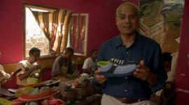 George Alagiah in shoe factory