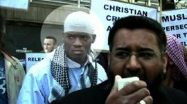 Alleged attacker Michael Adebolajo (Left, in white clothes)