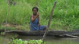 A woman in a canoe in the Niger Delta