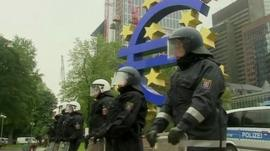 Police in front of euro sign