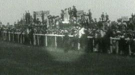 Still from British Pathe footage showing Emily Wilding Davison running onto the course at Epsom