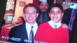 Camera image of Tony Blair and child