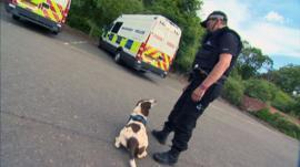 Sniffer dog and police handler