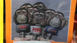 Cartoon depicting mainstream media as 'see no evil, hear no evil' monkeys
