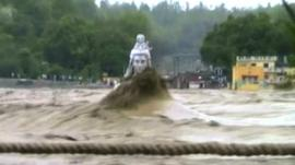 Statue of Hindu God submerged in flood waters