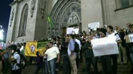 Protesters on the steps of Sao Paulo Cathedral