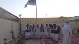 Still from video believed to be Taliban flag-raising in Doha