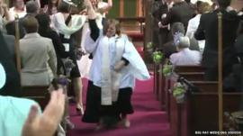 Vicar Kate Bottley leads a disco dance celebration at the end of a wedding ceremony in Blyth