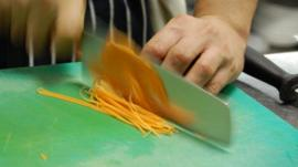 Chef slicing fresh pasta