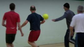Men playing sport