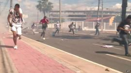 People apparently fleeing tear gas in Fortaleza, Brazil
