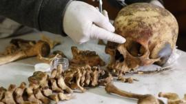 An archaeologist measures the remains of a women believed to be a member of the royalty of the Wari empire. Photo: 27 June 2013