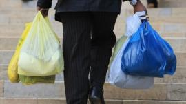 Man carrying plastic bags
