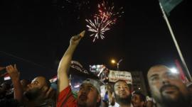 Fireworks above demonstrators in Nasr City, Cairo