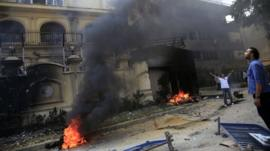 Protesters set fire to the Muslim Brotherhood's headquarters in Cairo