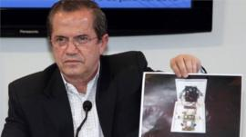 Ecuador's Foreign Minister Ricardo Patino shows a picture of a hidden spy microphone uncovered at the Ecuadorean ambassador to the UK