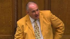 Robert Halfon in tangerine-coloured suit