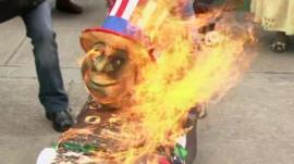 American symbols set on fire by protesters in Bolivia