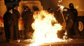 A petrol bomb hits police after it was thrown by loyalist rioters in the Woodvale area of north Belfast