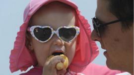Enjoying an ice-cream on Castle Hill beach in Tenby