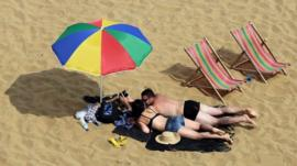 People on the beach in Broadstairs, Kent,