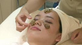 A woman having a snail facial