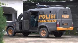 Police van outside Batam jail
