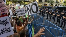 Demonstrators face police in Madrid, Spain