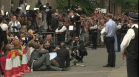 Journalists sat on the floor to keep out of shot
