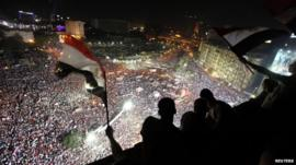 Protesters look down on Cairo's Tahrir Square, 26 July