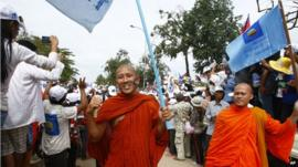 Monks carrying CNRP flags