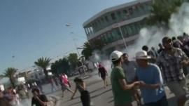 People flee tear gas in Tunis