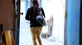 Woman leaving shop in Bizerte