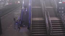 CCTV of man falling down escalator at Leeds station