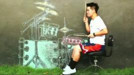 A Thai musician air drumming