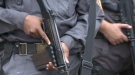 Police holding guns