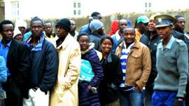 Zimbabweans queuing to vote
