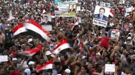 Members of the Muslim Brotherhood and supporters of deposed Egyptian President Mursi chant slogans at Rabaa Adawiya Square