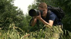 Sam Rowley taking wildlife photographs