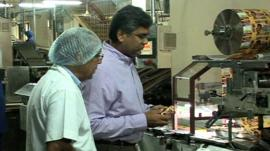 Ajay Chauhan examines biscuits in factory
