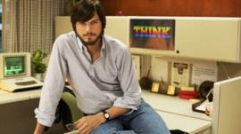This undated publicity photo released by the Sundance Institute shows Ashton Kutcher as Steve Jobs in the Open Roads Films movie,