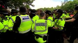 Police disperse an anti-fracking protest in Balcombe, West Sussex