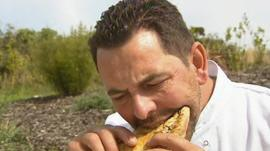 French chef Stephane Sauthier eating a Cornish pasty