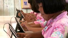 Thai children with tablet computers