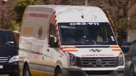 An ambulance arrives outside Nelson Mandela's home on 1 September 2013